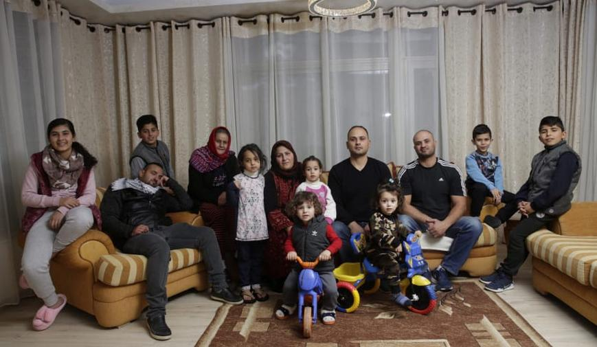 Members of the Sumarin family pose for a photo at their East Jerusalem home, March 23, 2018. Credit: Olivier Fitoussi
